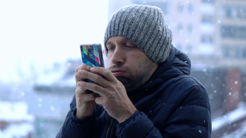 young man in city texting on smartphone during cold winter weather super slow motion 240fps rvgi8j p8l thumbnail full01